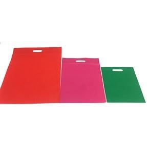 Imagen de Bolsa de TNT con asa sacabocado, varios colores